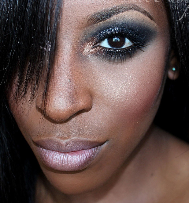 Blue Smokey eyes on dark skin and dark hair