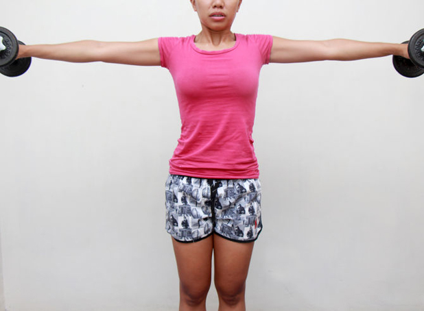 Stretching your arms by your side